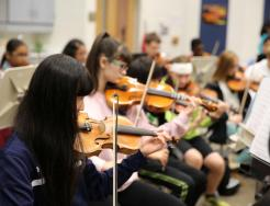 Discovery Middle School students in Orchestra class