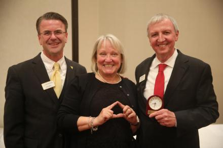 "Kathryn Lock, retiring teacher from Northpoint Elementary, does the ""The Triangle of Success"" with Supt. Dr. Thacker & Board Pres. Chris Riley"