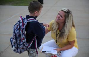 Ms. McCambridge welcomes a kindergartner on the 1st day (8/24/17)
